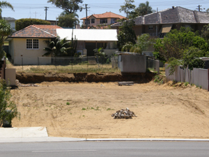 the empty block from which a house was recently demolished