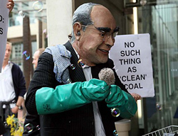 John Howard cleaning his coal